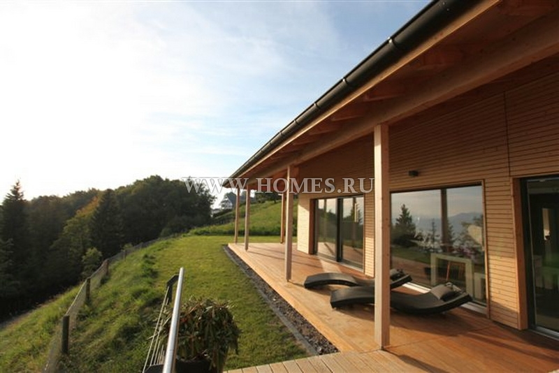 Современный дом с видом на Альпы в Мон Пелерин