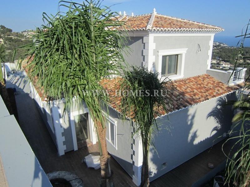 Новый дом с видом на море в Испании