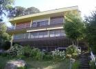 Современный дом на озере Монате